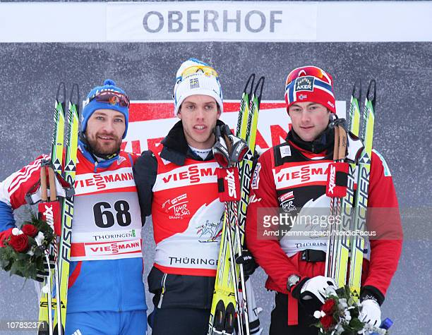 Second placed Alexei Petukhov of Russia winner Marcus Hellner of Sweden and third placed Petter Northug of Norway pose after the men's prologue for...