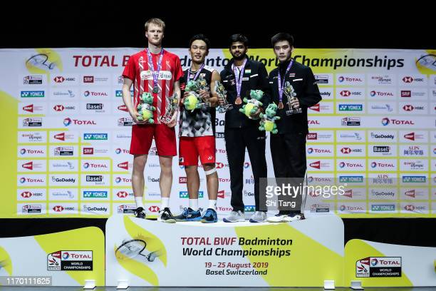 Second placed Anders Antonsen champion Kento Momota of Japan and third placed Sai Praneeth B of India and Kantaphon Wangcharoen of Thailand pose with...