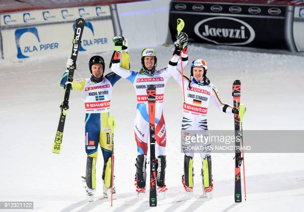Second placed Andre Myhrer of Sweden winner Ramon Zenhausern of Switzerland and third placed Linus Strasser of Germany celebrate after the FIS Ski...