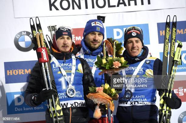 Second placed Andrejs Rastorgujevs of Latvia winner Anton Shipulin of Russia and third placed Quentin Fillon Maillet of France pose on podium after...