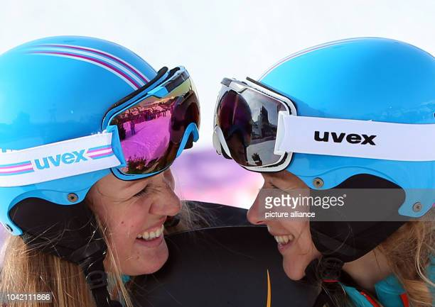 Second placed Anke Karstens of Germany celebrates with bronze medal winner Amelie Kober of Germany after the Ladies' Snowboard Parallel Slalom of the...