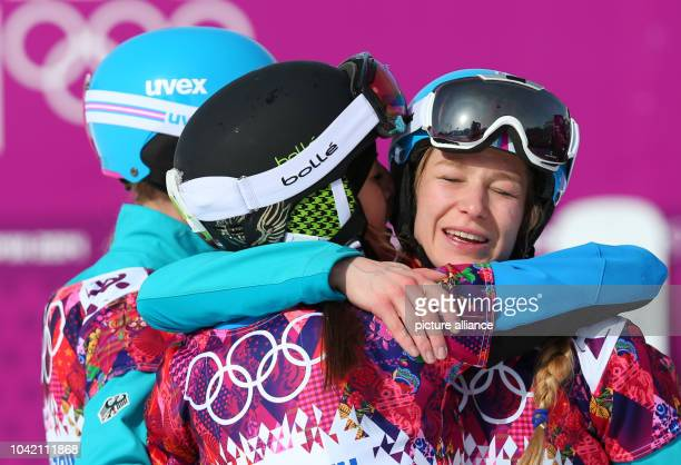 Second placed Anke Karstens of Germany gold medal winner Julia Dujmovits of Austria and third placed Amelie Kober of Germany celebrates after the...