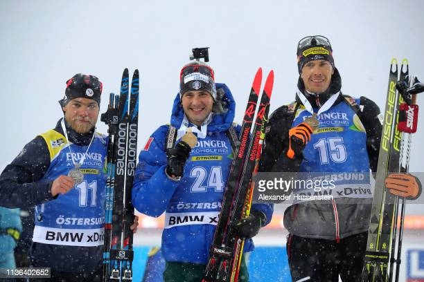 Second placed Antonin Guigonnat of France first placed Dominik Windisch of Italy and third placed Julian Eberhard of Austria pose with their medals...