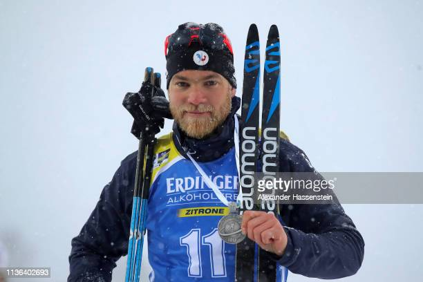 Second placed Antonin Guigonnat of France poses on the podium following the Men's Mass Start at the IBU Biathlon World Championships on March 17 2019...