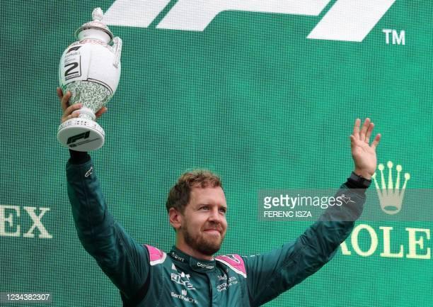 Second placed Aston Martin's German driver Sebastian Vettel celebrates on the podium after the Formula One Hungarian Grand Prix at the Hungaroring...