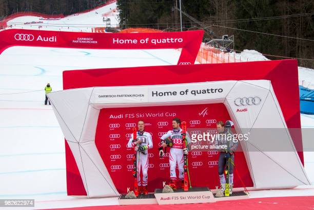 Second placed Austrian Manuel Feller winner Marcel Hirscher from Austria and American Ted Ligety who took third place pose during the award ceremony...