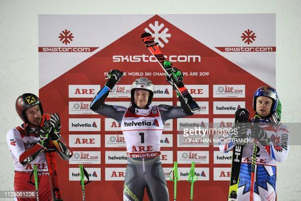 TOPSHOT Second placed Austria's Marcel Hirscher winner Norway's Henrik Kristoffersen and third placed France's Alexis Pinturault celebrate after the...