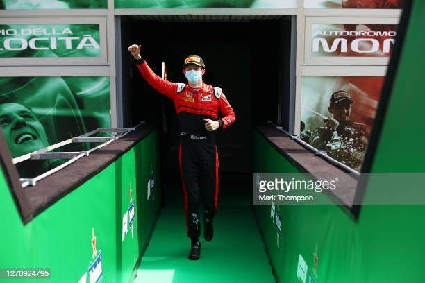 Second placed Callum Ilott of Great Britain and UNI-Virtuosi Racing celebrates on the podium during the sprint race for the Formula 2 Championship at...