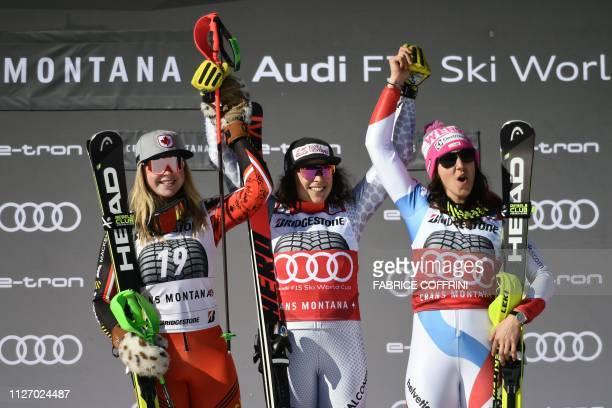 Second placed Canada's Roni Remme first placed Italy's Federica Brignone and third placed Switzerland's Wendy Holdener celebrate on the podium after...