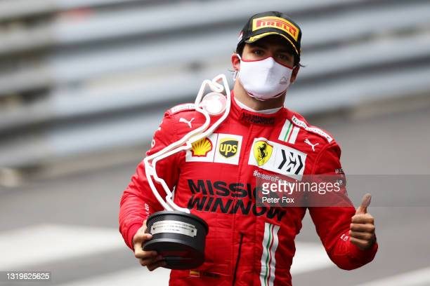 Second placed Carlos Sainz of Spain and Ferrari celebrates with his trophy in parc ferme during the F1 Grand Prix of Monaco at Circuit de Monaco on...