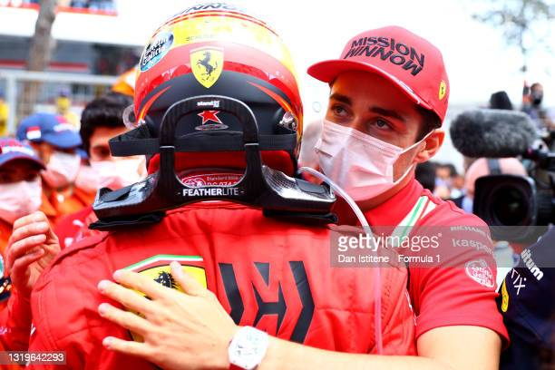 Second placed Carlos Sainz of Spain and Ferrari is congratulated by teammate Charles Leclerc of Monaco and Ferrari in parc ferme during the F1 Grand...