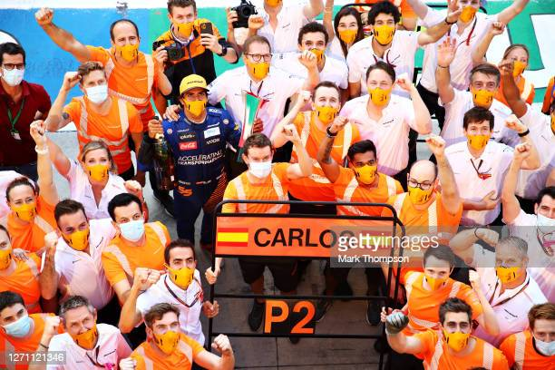 Second placed Carlos Sainz of Spain and McLaren F1 celebrates with team members after the F1 Grand Prix of Italy at Autodromo di Monza on September...