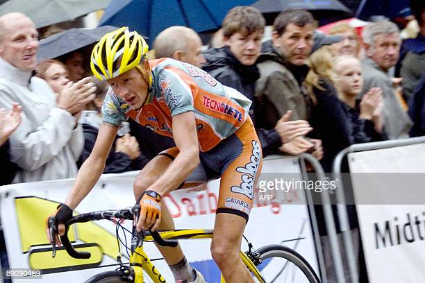 Second placed Danish cyclist Michael Rasmussen sprints during the Designa Grand Prix race on July 27 2009 in Kjellerup his first run after he was...