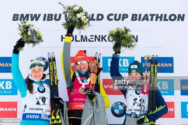 LR second placed Darya Domracheva from Belarus winner Anastasiya Kuzmina from Slovakia and third placed Yuliia Dzhima from Ukraine pose on the podium...