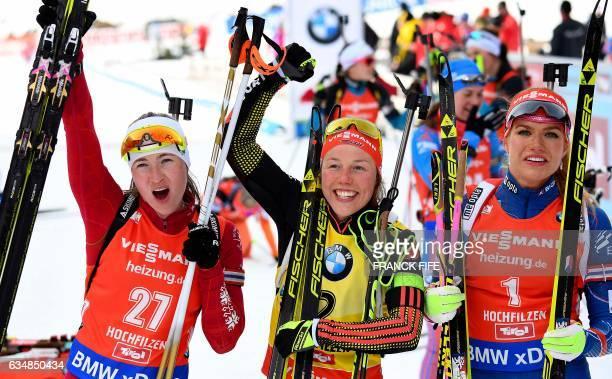 Second placed Darya Domracheva of Belarus, winner Laura Dahlmeier of Germany and third placed Gabriela Koukalova of Czech Republic celebrate in the...