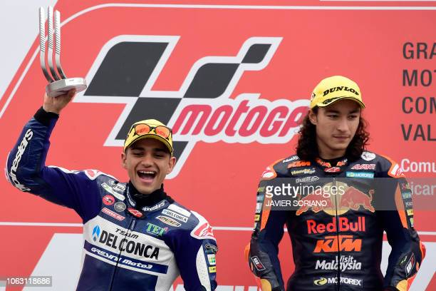 Second placed Del Conca Gresini Racing Moto3's Spanish rider Jorge Martin celebrates on the podium his second position beside Race winner Red Bull...