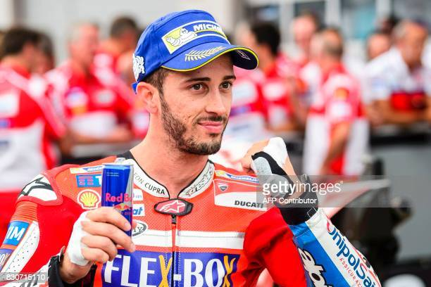 Second placed Ducati Team's Italian rider Andrea Dovizioso celebrates after the qualifying session of the MotoGP Austrian Grand Prix weekend at Red...
