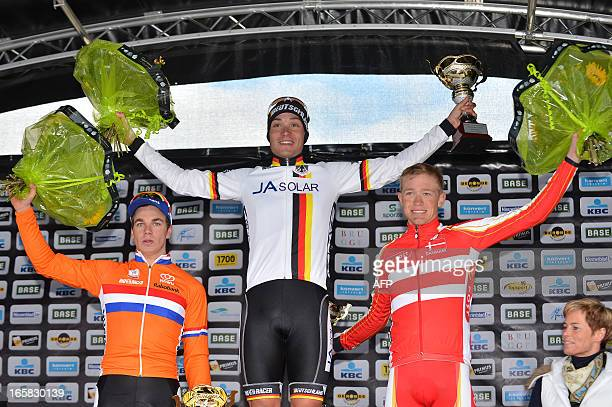 Second placed Dylan Groenwegen of The Netherlands first placed Rick Zabel of Germany and third placed Magnus Nielsen of Denmark celebrate on the...