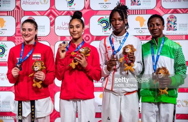 Second placed Egypt's Rewan Refaei winner Morocco's Safia Salih third placed Ivory Coast's Koumba Nanah Helene Ibo and Nigeria's Viviane Chinwe Ndu...