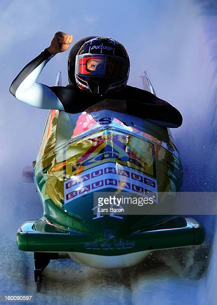 Second placed Elana Meyers and Katie Eberling of USA celebrate after the Women's Bobsleigh final heat of the IBSF Bob Skeleton World Championship at...