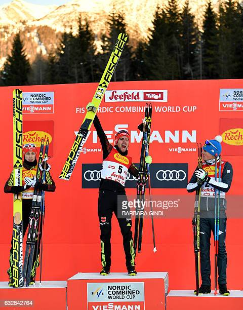 Second placed Eric Frenzel of Germany first placed Johannes Rydzek of Germany third placed Samuel Costa of Italy celebrate on the podium of the Men's...