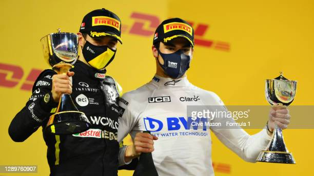 Second placed Esteban Ocon of France and Renault Sport F1 and third placed Lance Stroll of Canada and Racing Point celebrate on the podium during the...