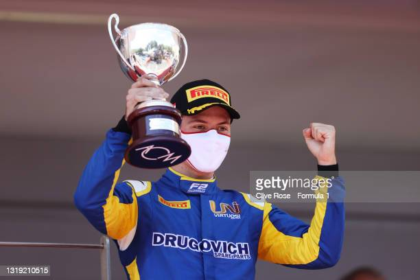 Second placed Felipe Drugovich of Brazil and UNI-Virtuosi Racing celebrates on the podium during Sprint Race 1 of Round 2:Monte Carlo of the Formula...