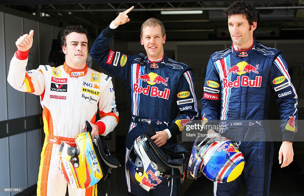 Second placed Fernando Alonso of Spain and Renault, pole sitter Sebastian Vettel of Germany and Red Bull Racing and third placed Mark Webber of Australia and Red Bull Racing celebrate in parc ferme following qualifying for the Chinese Formula One Grand Prix at the Shanghai International Circuit on April 18, 2009 in Shanghai, China.