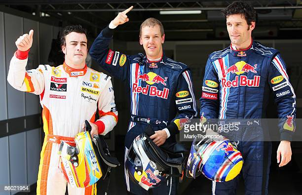 Second placed Fernando Alonso of Spain and Renault, pole sitter Sebastian Vettel of Germany and Red Bull Racing and third placed Mark Webber of...