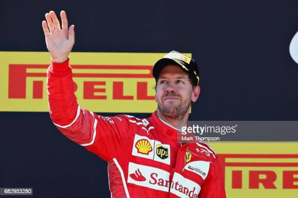 Second placed finisher Sebastian Vettel of Germany and Ferrari celebrates on the podium during the Spanish Formula One Grand Prix at Circuit de...