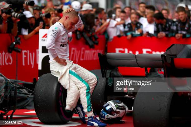 Second placed finisher Valtteri Bottas of Finland and Mercedes GP looks on in parc ferme during the Formula One Grand Prix of Germany at...