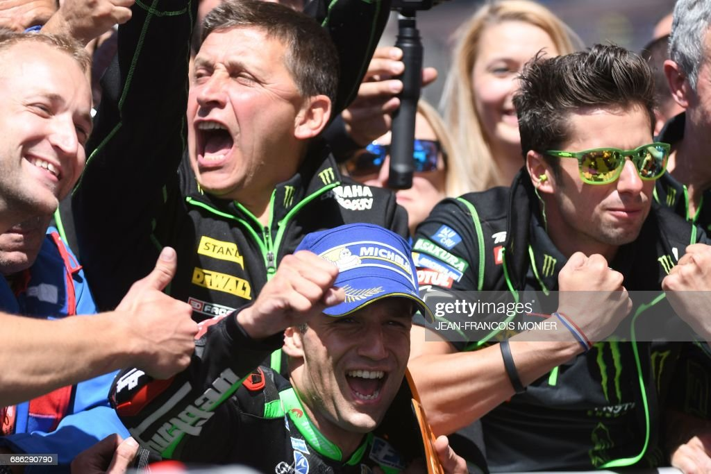 Second placed France's rider Johann Zarco (bottom, C) and mechanics celebrate after the MotoGP race of the French Motorcycle Grand Prix, on May 21, 2017 in Le Mans, northwestern France. /