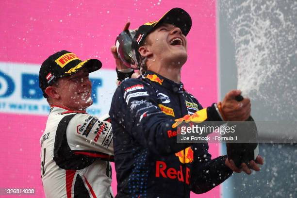 Second placed Frederik Vesti of Denmark and ART Grand Prix and third placed Dennis Hauger of Norway and Prema Racing celebrate on the podium during...