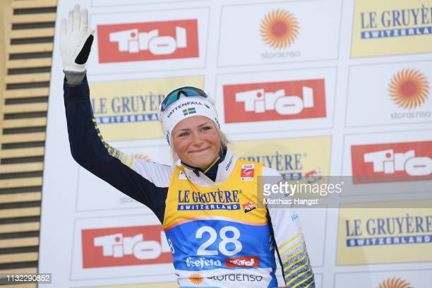 Second placed Frida Karlsson of Sweden celebrates on the podium after the CrossCountry Women's 10k race of the FIS Nordic World Ski Championships at...