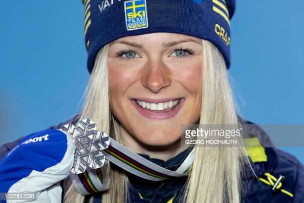 Second placed Frida Karlsson of Sweden celebrates on the podium during the medal ceremony for the Women's Cross Country 10km classic race of the 2019...