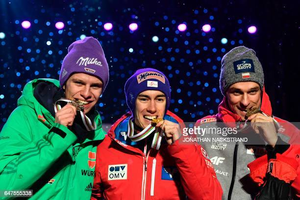 Second placed Germany's Andreas Wellinger, winner Austrian Stefan Kraft and third placed Poland's Piotr Zyla celebrate during the medals ceremony for...