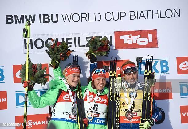 Second placed Germany's Maren Hammerschmidt, winner Germany's Laura Dahlmeier and third placed Czech's Gabriela Soukalova celebrate on the podium of...