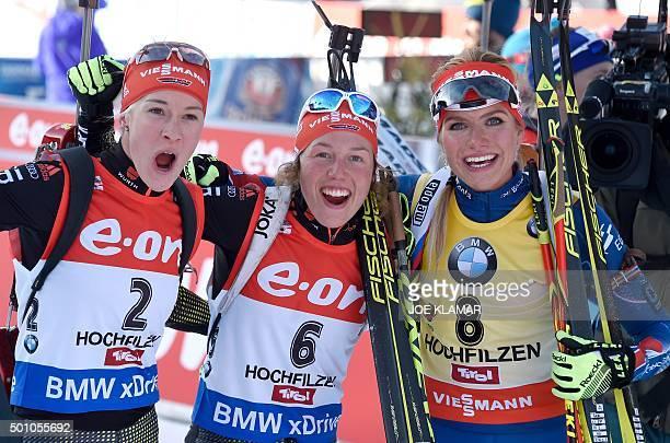Second placed Germany's Maren Hammerschmidt, winner Germany's Laura Dahlmeier and third placed Czech's Gabriela Soukalova celebrate after the women's...