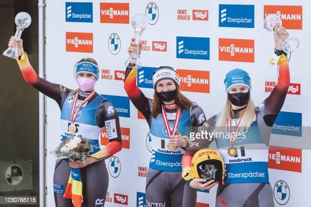 Second placed Germany's Natalie Geisenberger, overall World Cup winner Germany's Julia Taubitz and third placed Germany's Dajana Eitberger celebrate...