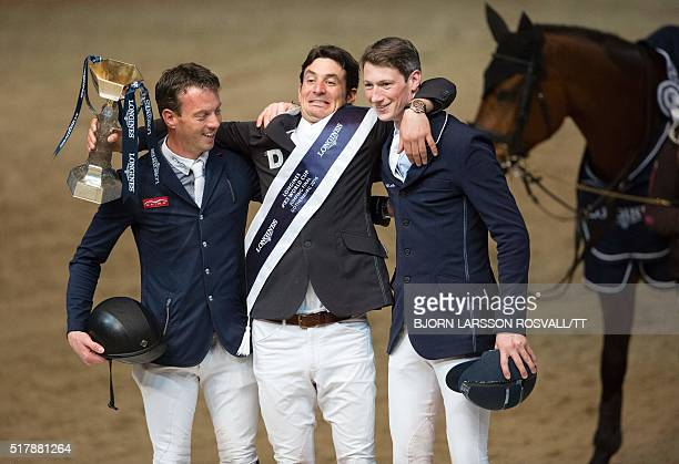 Second placed Harrie Smolders of the Netherlands winner Steve Guerdat of Switzerland and third placed Daniel Deusser of Germany pose after the...
