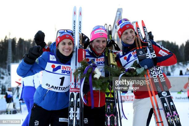 Second placed Heidi Weng of Norway first place Marit Bjoergen of Norway and third place Astrid Uhrenholdt Jacobsen of Norway pose following the...