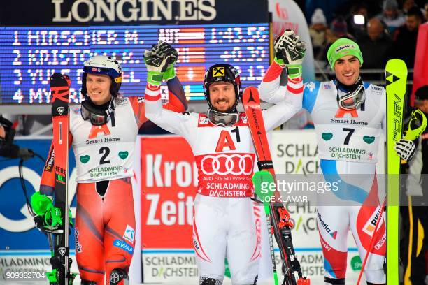 Second placed Henrik Kristoffersen of Norway Winner Marcel Hirscher of Austria and third placed Daniel Yule of Switzerland celebrate after competing...