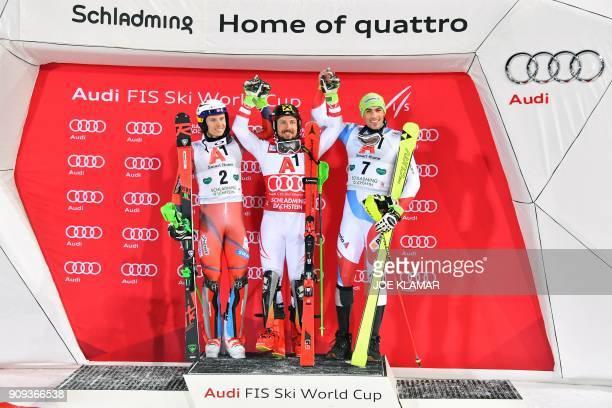 Second placed Henrik Kristoffersen of Norway Winner Marcel Hirscher of Austria and third placed Daniel Yule of Switzerland celebrate on the podium...