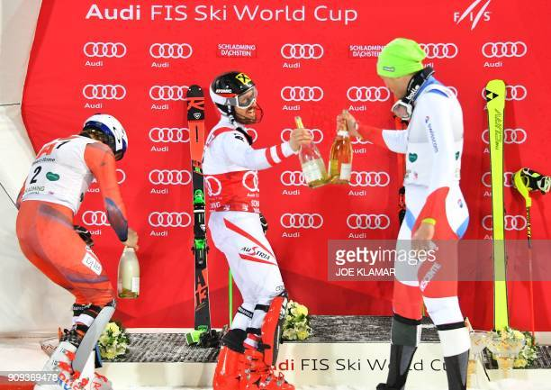 Second placed Henrik Kristoffersen of Norway Winner Marcel Hirscher of Austria and third placed Daniel Yule of Switzerland celebrate with Champagne...