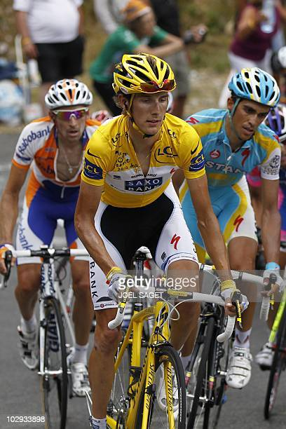 Second placed in the overall standings, Spain's Alberto Contador , rides with Yellow jersey of Overall leader, Luxembourg's Andy Schleck and fourth...