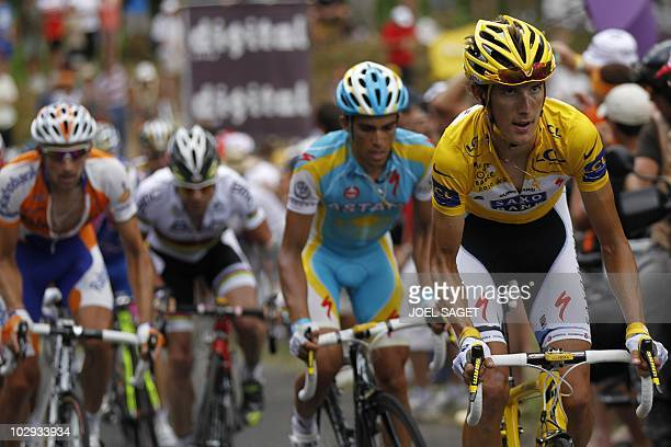 Second placed in the overall standings, Spain's Alberto Contador rides with Yellow jersey of Overall leader, Luxembourg's Andy Schleck , Australia's...