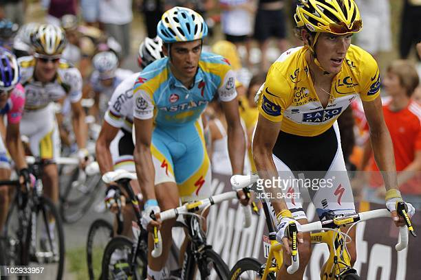 Second placed in the overall standings, Spain's Alberto Contador , rides with Yellow jersey of Overall leader, Luxembourg's Andy Schleck in the 210,5...