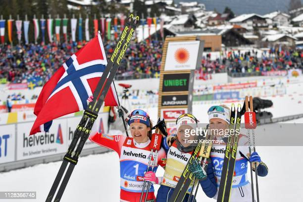 Second placed Ingvild Flugstad Ostberg of Norway first placed Therese Johaug of Norway and third placed Frida Karlsson of Sweden pose on behind the...