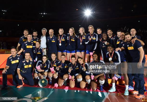 Second placed Italian volleyball players and coaches pose during the awards ceremony of the 2018 FIVB World Championship volleyball women's final...