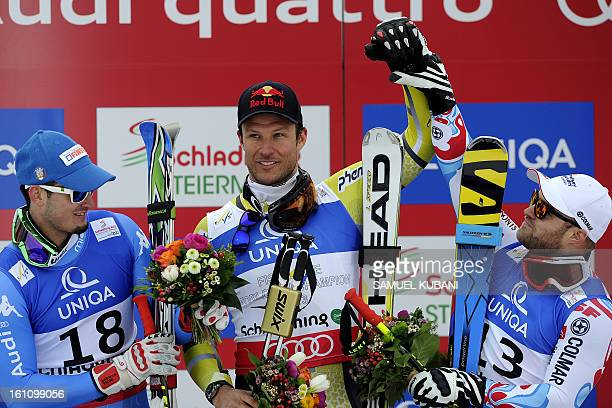 Second placed Italy's Dominik Paris winner Norway's Aksel Lund Svindal and third placed France's David Poisson pose during a photocall after the...